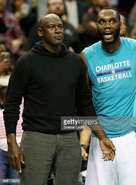Owner of the Charlotte Hornets Michael Jordan talks to player Al Jefferson during their game against the Washington Wizards at Time Warner Cable...