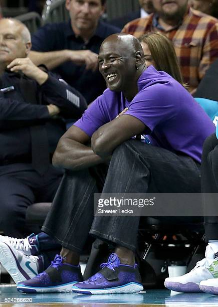Owner of the Charlotte Hornets Michael Jordan watches on from the bench against the Miami Heat during game four of the Eastern Conference...