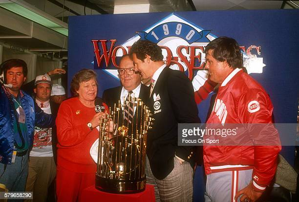 Owner of the Cincinnati Reds Marge Schott commissioner Fay Vincent CBS announcer Jim Kaat and Manager Lou Piniella stands with the World Series...
