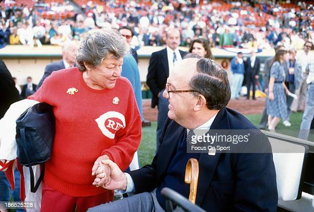 Owner of the Cincinnati Reds Marge Schott talk with Commissioner Fay Vincent prior to the start of Game four of the World Series between the...
