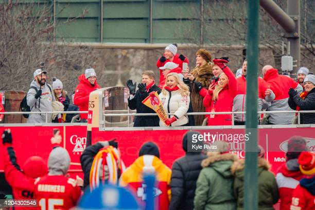 Owner of the Kansas City Chiefs Clark Hunt and his wife Tavia Shackles wave at fans during the Kansas City Super Bowl parade on February 5 2020 in...