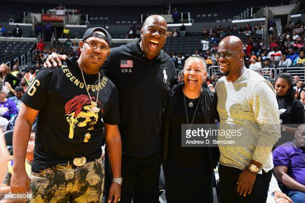 Owner of the Los Angeles Sparks Magic Johnson poses for a picture with WNBA President Lisa Borders and sports agent Aaron Goodwin and rapper Master P...