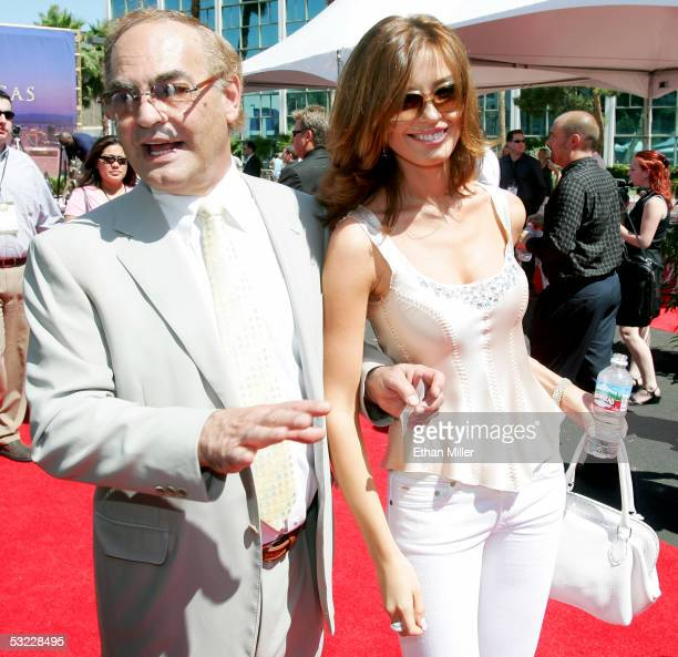 Owner of the New Frontier Hotel and Casino Phil Ruffin and his fiancee Oleksandra Nikolayenko leave after a ceremonial groundbreaking for the 64story...
