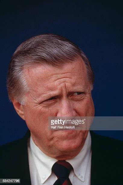 Owner of the New York Yankees George Steinbrenner waits in the dugout before a game in Chicago