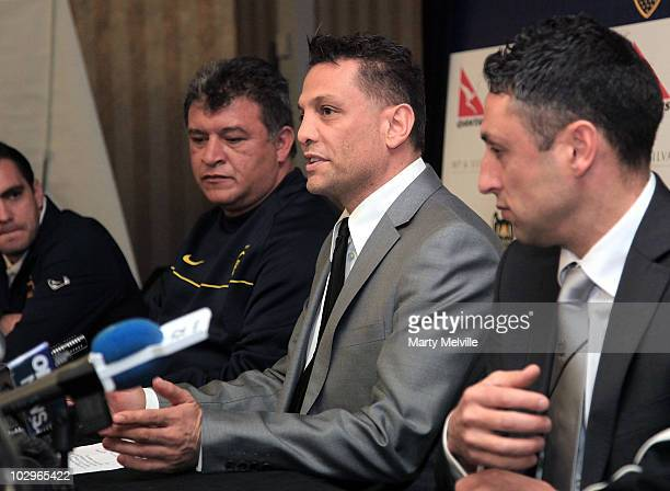 Owner of the Phoenix Terry Serepisos speaks to the media with Boca Juniors head coach Claudio Borghi during a press conference at the...