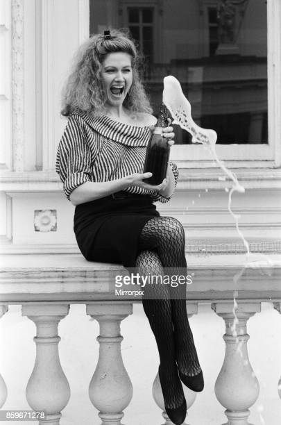 Owner of the Pineapple Dance Studios Debbie Moore celebrates after being named 'The Veuve Clicquot' Businesswoman of the Year 12th March 1984