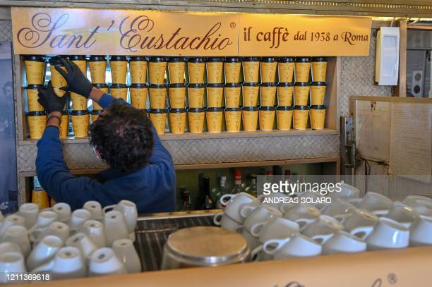 Owner of the Sant'Eustachio cafe Raimondo Ricci sorts takeaway coffe cups in his establishment on April 30 2020 in Rome during the country's lockdown...