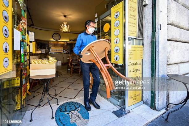 Owner of the Sant'Eustachio cafe Raimondo Ricci works in his establishment on April 30 2020 in Rome during the country's lockdown aimed at curbing...