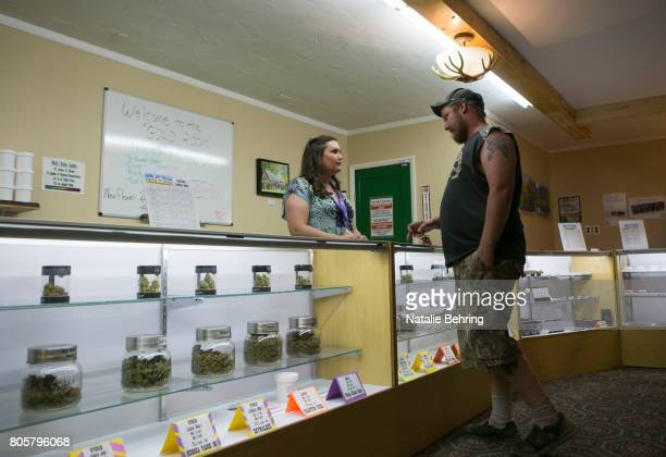 Owner of the Sumpter Nugget dispensary Jenny Long restocks inventory July 2 2017 in Sumpter Oregon City leaders had a chance to opt out of having...