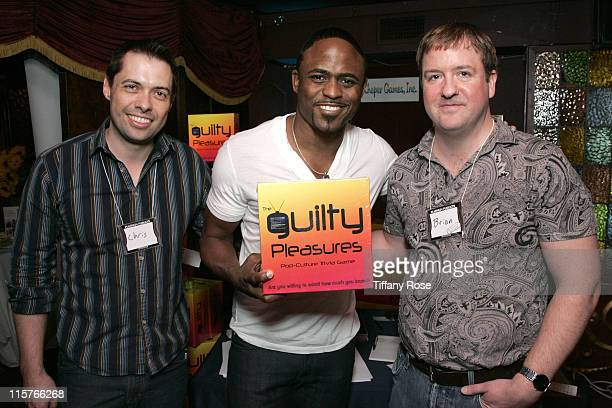 Owner of Wild Party Games Chris Bierrum actor Wayne Brady and CEO of Kheper Games Inc Brian Pellham pose with Kheper Games Guilty Pleasures...