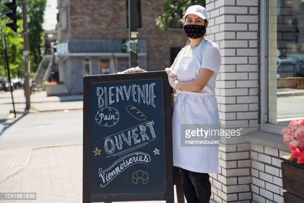 owner opening her store with protective mesure againts covid-19. - montreal stock pictures, royalty-free photos & images