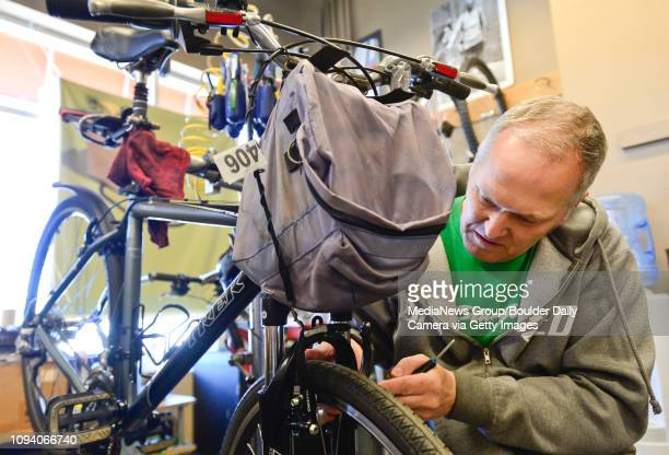 Owner Pete Schones adjusts the front brakes on a customer's bike at Acme Bikes in Longmont on Thursday More photos TimesCallcom