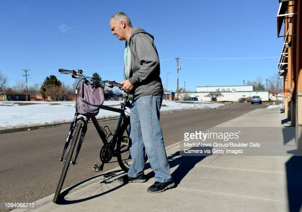 Owner Pete Schones brings a customer's bike out of the shop for a test ride after making adjustments on the brakes at Acme Bikes in Longmont on...