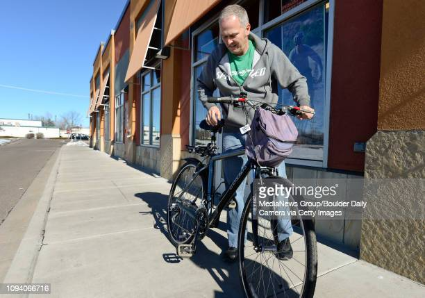 Owner Pete Schones test rides a customer's bike after making adjustments on the brakes at Acme Bikes in Longmont on Thursday More photos TimesCallcom