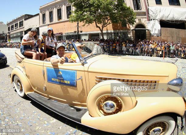 Owner Peter Guber of the Golden State Warriors waves to the crowd during the Golden State Warriors Victory Parade on June 12 2018 in Oakland...