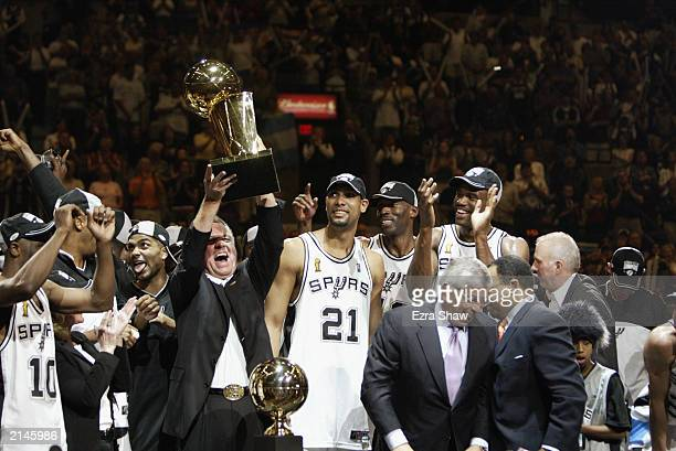 Owner Peter Holt of the San Antonio Spurs holds the Championship trophy after defeating the New Jersey Nets in game six of the 2003 NBA Finals to win...