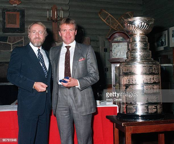 Owner Peter Pocklington and Head Coach Glen Sather of the Edmonton Oilers pose for a photo next to the Stanley Cup circa 198485 in Edmonton Alberta...
