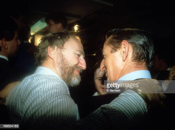 Owner Peter Pocklington of the Edmonton Oilers and Walter Gretzky talk in the locker room after the Oilers defeated the New York Islanders in Game 5...