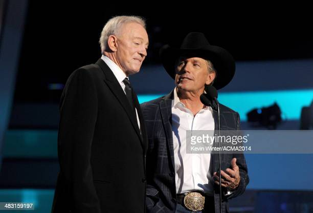 Owner President and General Manager of the Dallas Cowboys Jerry Jones and recording artist George Strait speak onstage during the 49th Annual Academy...