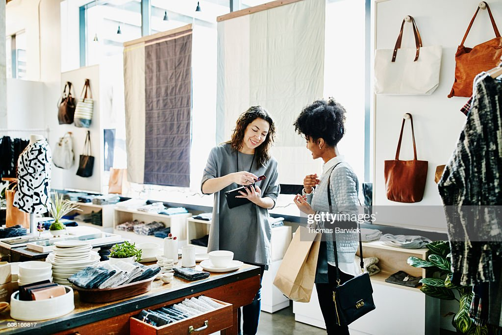Owner processing credit card with digital tablet : Stock Photo