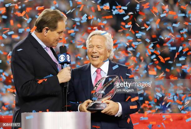 Owner Robert Kraft of the New England Patriots holds the Lamar Hunt trophy as he is interviewed by Jim Nantz after the AFC Championship Game against...