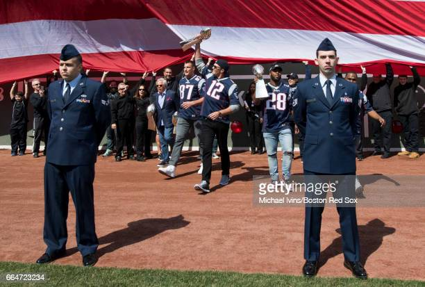 Owner Robert Kraft Rob Gronkowski Tom Brady James White and Dion Lewis of and the New England Patriots take the field during a ceremony in...