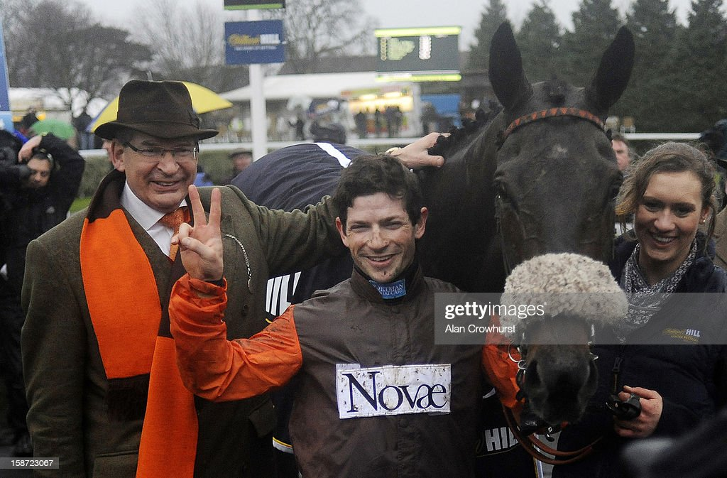 Owner Robert Waley-Cohen (L) and Sam Waley-Cohen pose after riding Long Run to win The William Hill King George VI Steeple Chase at Kempton racecourse on December 26, 2012 in Sunbury, England.