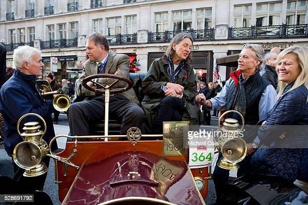 Owner Robin Morrison company in and around his 1904 Cadillac in Regent Street London