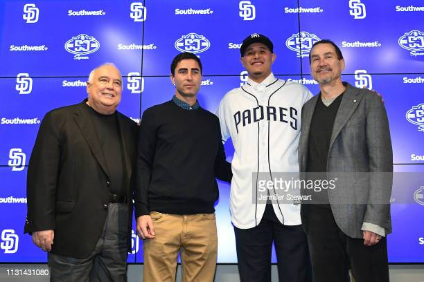 Owner Ron Fowler, Executive V.P./General Manager A.J. Preller, Manny Machado of the San Diego Padres pose for a photo at Peoria Stadium on February...