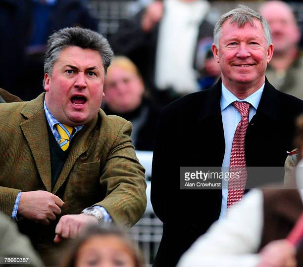 Owner Sir Alex Ferguson and trainer Paul Nicholls watch as What a Friend wins at Chepstow Racecourse on December 27 2007 in Chepstow Wales