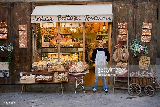 owner standing in front of deli - delicatessen stock pictures, royalty-free photos & images