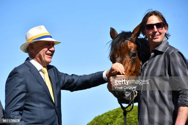 Owner Terry Henderson poses with Aloisia after winning Race 6 Schweppes Thousand Guineas during Melbourne Racing on Caulfield Guineas Day at...