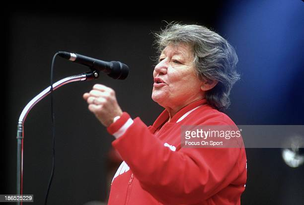Owner the Cincinnati Reds Marge Schott speaks to the fans prior to the start of Game Two of the 1990 World Series between the Oakland Athletics and...