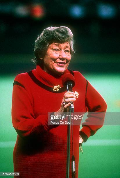 Owner the Cincinnati Reds Marge Schott speaks to the fans prior to the start of Game One of the 1990 World Series between the Oakland Athletics and...