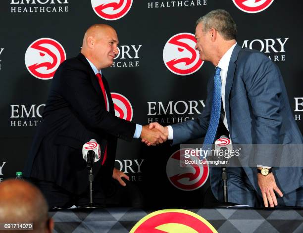 Owner Tony Ressler of the Atlanta Hawks shakes hands with the new General Manager Travis Schlenk during a Press Conference on June 2 2017 at Philips...