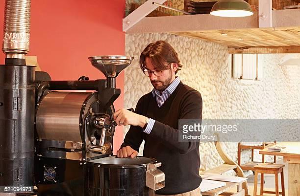 Owner using coffee roaster