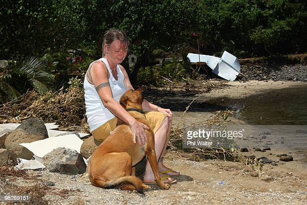 Owner Wendy Booth and her dog look on at the devastation of her destroyed Seabreeze resort following the 8.3 magnitude strong earthquake which struck...