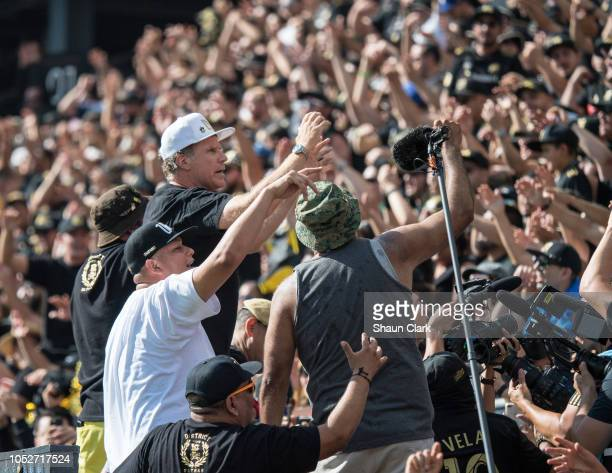 LAFC owner Will Ferrell organizes the 3252 supporters during Los Angeles FC's MLS match against Vancouver Whitecaps FC at the Banc of California...