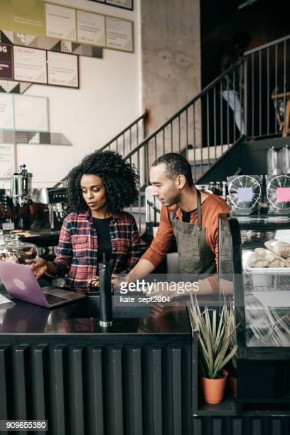owner working on tax - tea room stock pictures, royalty-free photos & images