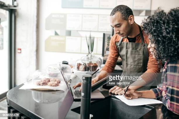 owner working on tax - business owner stock photos and pictures