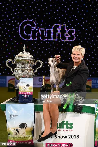 Owner Yvette Short smiles as Tease the Whippet wins Best In Show on day four of the Cruft's dog show at the NEC Arena on March 11 2018 in Birmingham...