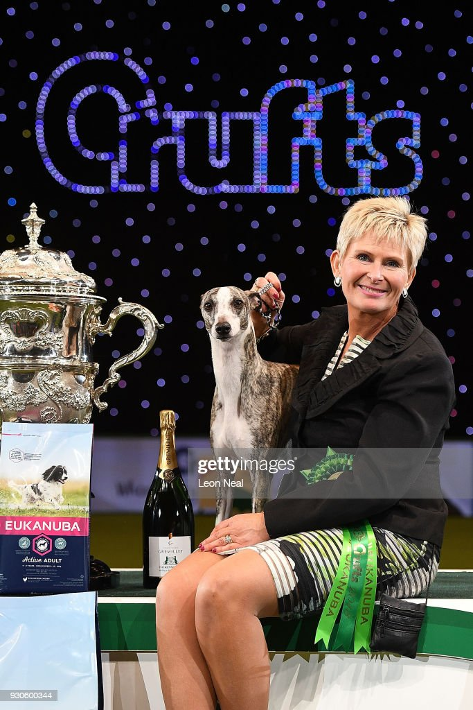 Owner Yvette Short smiles as Tease the Whippet wins Best In Show on day four of the Cruft's dog show at the NEC Arena on March 11, 2018 in Birmingham, England.