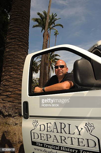 Owner/operator Scott Michaels who calls himself the director of undertakings for his Dearly Departed Tours poses with his van on Sunset Blvd in...