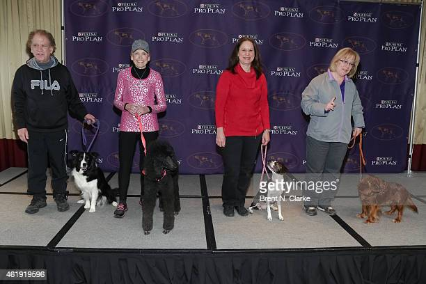 Owners Arthur Selkin Marge Yonda Karen Profenna and Kristine Schmidt pose with 'Lynus' a Border Collie 'Maggie' a Standard Poodle 'Hailey' an All...