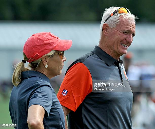 Owners Jimmy and Dee Haslam of the Cleveland Browns walks onto the field during training camp on July 31 2016 at the Cleveland Browns training...