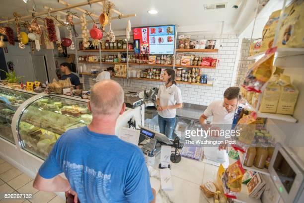 Owners Maria and Ettore Rusciano serve customers at Salumeria 2703 at Salumeria 2703