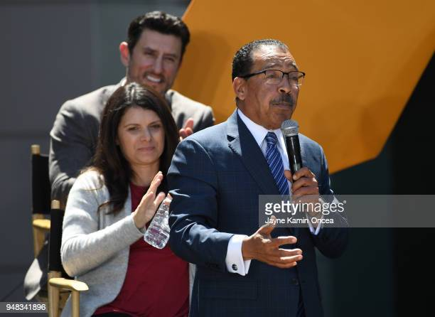 Owners Nomar Garciaparra and Mia HammGarciaparra applaud as Los Angeles City Council President Herb Wesson speaks to fans and media at the ribbon...