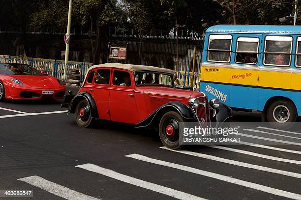 Owners of a 1939made Austin car drive during a vintage car rally in Kolkata on January 19 2014 This year 175 vintage and classic vehicles are...