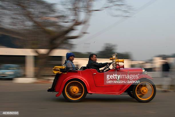 Owners of a 1943made Morris car drive during a vintage car rally in Kolkata on January 19 2014 This year 175 vintage and classic vehicles are...