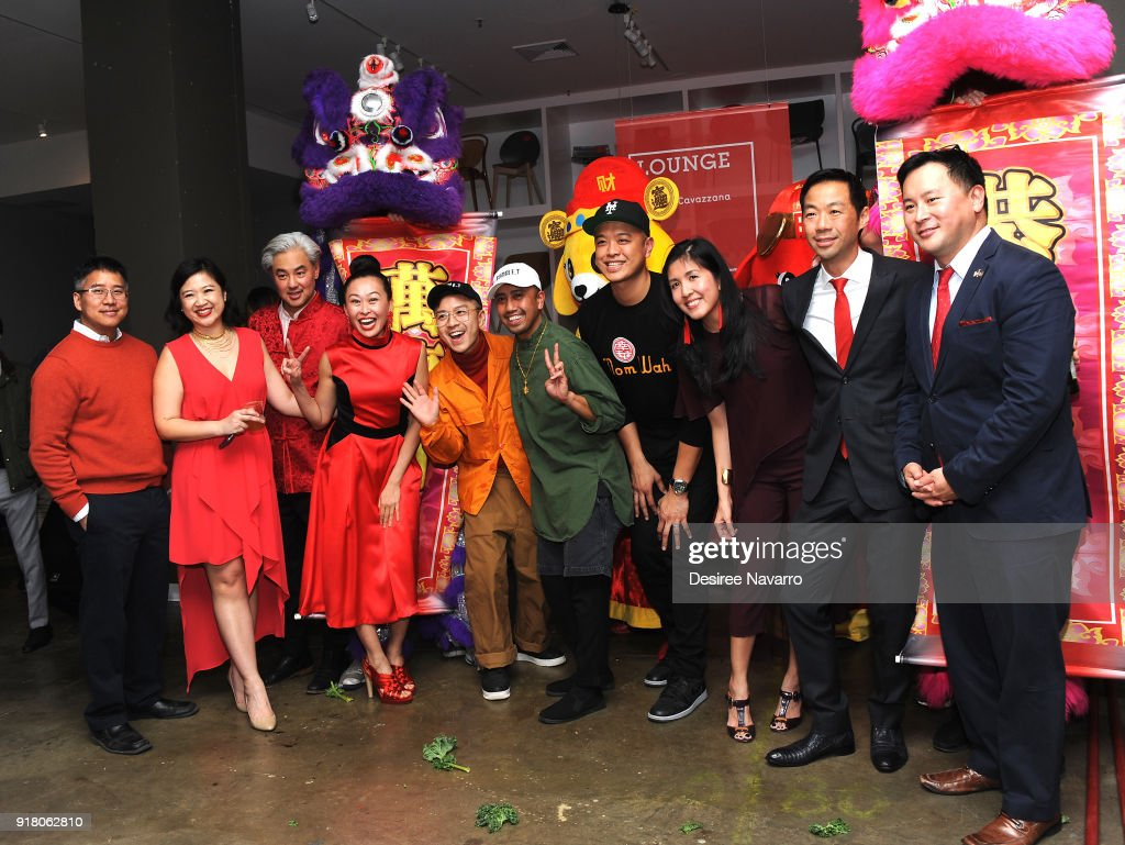 Owners of Calligaris, Shaokao Cheng and Niki Cheng pose with guests for photos during the 2018 Red & Gold Party at Calligaris SoHo on February 13, 2018 in New York City.